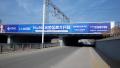 内蒙古呼和浩特市新城区火车东站铁路桥双向三面翻广告牌