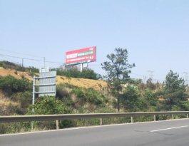 云南昆明西石高速小喜村收费站口高速公路多面翻大牌